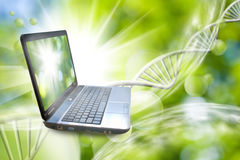 Image of notebook on DNA chains background Stock Photo
