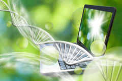 Image of notebook on DNA chains background. The image symbolizes the innovative technologies in the field of chemistry and biotechnology royalty free stock images