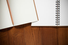 Image of a notebooks and pencil on the desk Stock Image