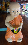 Image of novice with arm bowl. Novice, monk, oriental painting pattern religion siam statue style tale temple thai wat young art asia asian bowl buddhism Stock Photography