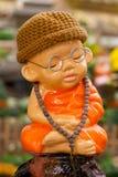 Image of novice in garden. Image of novice at meditation in garden stock photo