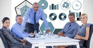 Image numérique des gens d'affaires lors de la réunion contre des graphiques Image stock