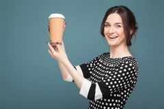 Image Of Beautiful Woman In Speckled Clothes Standing With Coffe In Hands Stock Photo