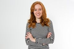 Free Image Of Cheerful Pretty Young Redhead Lady Standing Isolated Over White Wall Background. Looking Camera. Happy Girl Royalty Free Stock Photo - 176551465