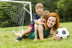 Image Of Family, Mother And Son Playing Ball In The Park Stock Photography