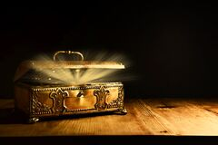 Free Image Of Mysterious Magical Treasure Chest With Light Over Wooden Old Table And Dark Background Stock Photos - 215051923