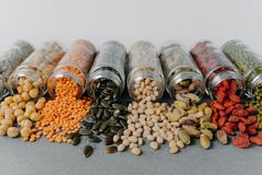 Free Image Of Nutrient Pinenuts, Mung Beans, Sunflower Seeds, Chickpea, Pistachio Spilled From Glass Containers. Healthy Nutrition Royalty Free Stock Photo - 171360155