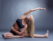 Image Of Smiling Young Woman Doing Stretching Stock Photo