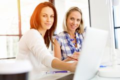 Image Of Two Young Business Women In Office Royalty Free Stock Photo