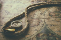 Image of old compass and rope on vintage map Royalty Free Stock Photo