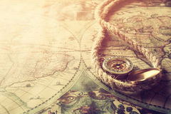 Image of old compass and rope on vintage map Royalty Free Stock Photography