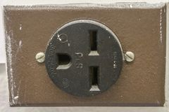 Old Electric Receptacle. Image of an Old Electric wall Receptacle from an old building royalty free stock photo
