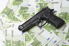 Image of the old gun and money Stock Photo