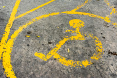 Image of old Handicapped symbol on parking space . Royalty Free Stock Image