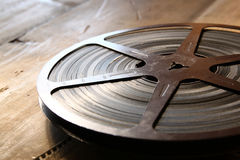 Image of old 8 mm movie reel over wooden background. retro style image Stock Image