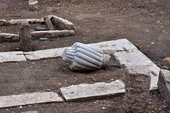 Image of old ottoman Muslim graveyard remains excavated with tombstones. View of water plumbing and gas pipe installations in ground. Rectangular concrete Royalty Free Stock Photography