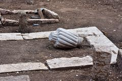 Image of old ottoman Muslim graveyard remains excavated with tombstones. View of water plumbing and gas pipe installations in ground. Rectangular concrete Royalty Free Stock Image