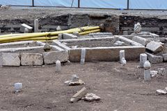 Image of old ottoman Muslim graveyard remains excavated with tombstones. View of water plumbing and gas pipe installations in ground. Rectangular concrete Stock Photography