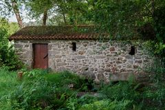 Old stone house in the forest. Image of old stone house in the forest Royalty Free Stock Photography