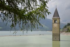 Image of the old sunken church Lake Resia Reschen south tyrol italy Royalty Free Stock Image