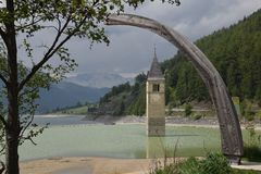 Image of the old sunken church Lake Resia Reschen south tyrol italy Royalty Free Stock Photos