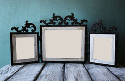 Image of old victorian steel blue blank frame . retro filtered image Royalty Free Stock Photo