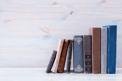 Image of old vintage books on a wooden shelf Stock Photos