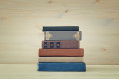 Image of old vintage books on a wooden shelf Royalty Free Stock Images