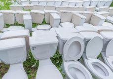 Waste flush toilet outdoor . Image of old waste flush toilet outdoor . Arrange, bathroom, bowl, broken, brush, ceramic, clean, cleaner, crap, design, dirty stock photography