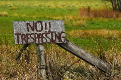 Old Weathered No Trespassing Sign royalty free stock images