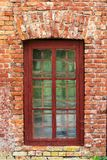 An image of old window on red brick wall. stock photos