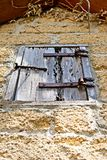 A wooden window cover on an old brick building on  grounds of the Gonzalez Alvarez House in Historic St. Augustine, Florida. This is an image of an old wooden Royalty Free Stock Photo