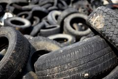 Old Damaged and Worn Out Tires for Recycling. An image of old worn out tires in a landfill waiting to be collected and recycled royalty free stock photos