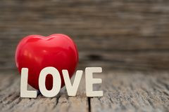 Image-One Heart and love word on wooden background. Copy space Valentines day. Concept royalty free stock image
