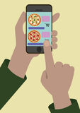 Image of the Online Order of Pizza. The image of phone in hands of the person who does the online order of pizza Royalty Free Stock Image
