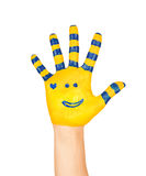 image of an open hand yellow with blue stripes and a pretty smal Royalty Free Stock Photo