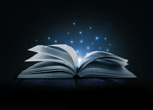 Image of opened magic book. With magic lights Stock Images