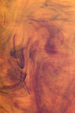 Image orange abstraite d'encre   Photographie stock