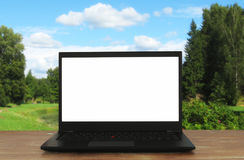 Image of outdoors with open laptop and empty white screen for copy space stock photos