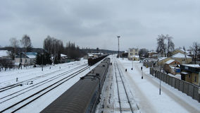 Panorama to railway station and rails in winter Royalty Free Stock Photo
