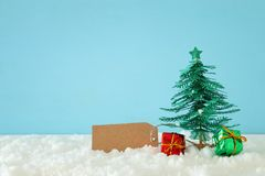 Image of paper christmas trees over white snow. stock image