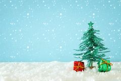 Image of paper christmas trees over white snow. stock images