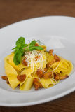 Image of pasta with chanterelle served in white dish. Close image of pasta with cheese Stock Image