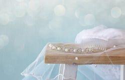 Image of pearls tiara on toilet table. Glitter overlay. Stock Photos