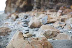 Image of Pebble tower on the beach. Close-up of Stone wishing Pyramid at the seaside stock image