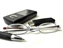 Personals office item. Image of pen drive phone glaseses and pen Royalty Free Stock Photo