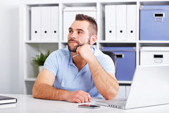 Image of pensive young businessman with notebook looking up Royalty Free Stock Photo
