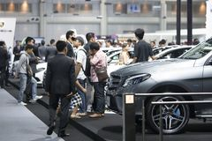 Image of people in cars exhibition show at Motor Show. Bangkok-Thailand-3 December 2017: image of people in cars exhibition show at Motor Show Muangthong 2017 royalty free stock photos