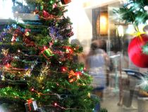 People at shopping and Christmas-tree. An image of people at shopping and Christmas-tree Royalty Free Stock Photography