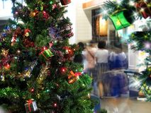 People at shopping and Christmas-tree. An image of people at shopping and Christmas-tree Stock Image